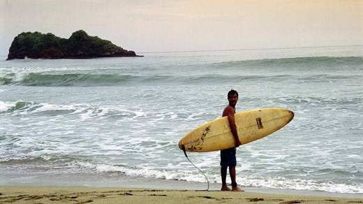 Surfer on the beach in Costa Rica.
