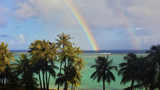 Beautiful rainbow over an island in Micronesia.