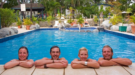 Backpackers chilling by the pool in Nadi