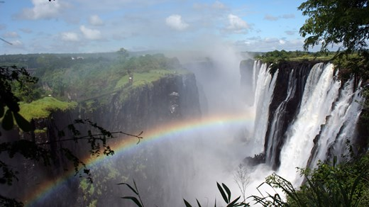 Somewhere over the rainbow in Victoria Falls. A must-see when you travel to Zambia