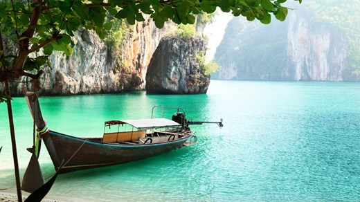 Krabi - Longtail boat and the charactaristic green ocean water