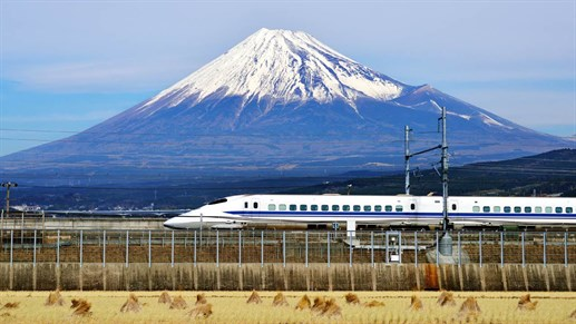 Japanese train in front of Mount Fuji